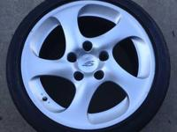 I have a set of four Porsche 4S wheels and tires that