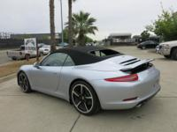 2014 Porsche 911 S with 7k miles. This coupe is fully