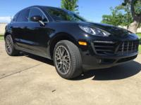 This beautiful Black/Black 2015 Porsche Macan S is