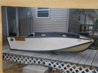 8 Ft folding Port-a-Bote.  Folds down to the size
