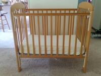 Light Honey Colored Wood Porta Crib / Portable Crib.