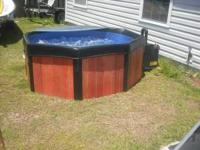Portable hot tub for sale. Fits four people. Very easy
