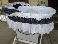 Portable bassinet with stand. Bassinet part detaches,
