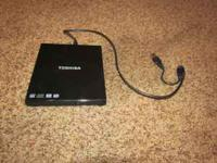 Toshiba brand Portable SuperMulti Drive for sale. Plays