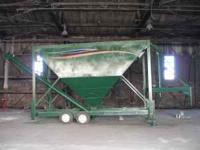 Portable tank/bin. Loads by numatic tank truck, unloads