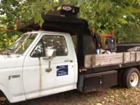 1982 Ford F-350 with a Tommy Lift Gate, bed large
