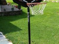 Lifetime portable and adjustable basketball hoop.