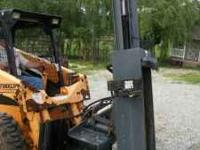SHAVER HD 12 POST POUNDER. ATTACHES TO SKID LOADER.