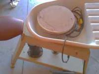 I have a Potters wheel with seat and water well.