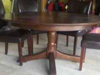 "Barely used formal 60"" round dining table from Pottery"