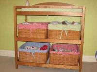 Changing table with 4 baskets, in great shape. You can