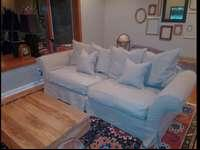 Couch is in great shape. Comes with two slip covers,