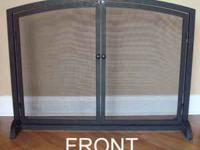 This beautiful fireplace screen is NEW. I bought it at