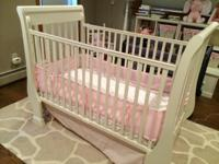 I have a sleigh design crib from Pottery Barn Kids ...