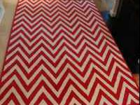 100% handtufted wool Pottery Barn rug in a red and