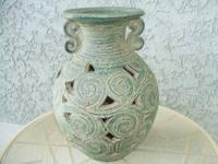 "Pottery green vase 11"" tall. Cut-out design. $10."