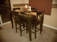I am selling a bar top kitchen table with 4 matching