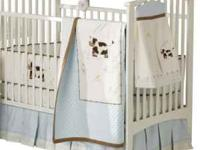 Moo-cow bedding set by sumersault from Pottery Barn.
