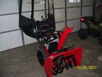 This snow blower is like new used very little it has a