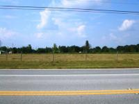 Commercial corner. Traffic light in place. 1.79 acres