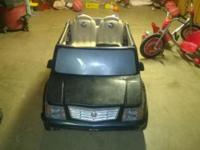 Power Wheels Cadillac Escalade. Runs well and radio