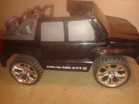 This slightly used Power Wheels Cadillac Escalade EXT