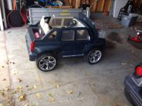 power wheels ride on escalade. Good condition. Battery
