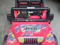 a power wheels jeep wrangler in nice shape, comes with