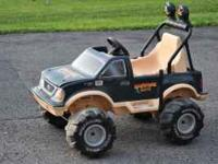 Power Wheels Truck w/charger. Needs a new battery, the