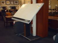 This is a 4? x 3?, powered drafting table, manufactured