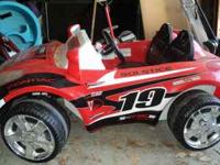 Race car powered with battery and charger and working
