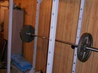 Near new Powerline rack with pull up bar & adjustable