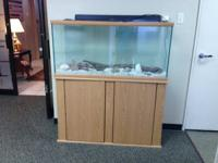 For sale: A 62 gallon saltwater aquarium with stand.