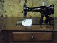 for sale pre 1950 singer 15 sewing machine in cabinet.