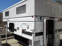 Pre-owned 4WC Grandby C7964 Truck Camper. The FOUR