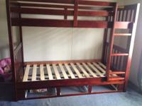This is a great pre owned twin bunk bed in great