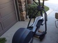 Precor elliptical with arm motion. Several programs and