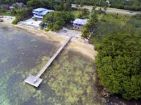 Beachfront home situated on 3/4 of an acre with