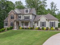 Meticulouslynmaintained, this custom home, completed