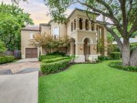 Situated on picturesque Park Lane in North Dallas, this