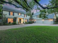 Located on a heavily treed lot just under an acre in