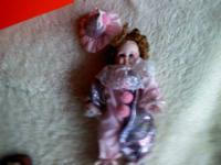 I have a pretty girl doll with a satiny clown outfit