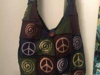 Selling my very pretty new and never worn PEACE bag. It