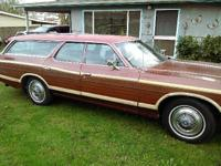 This is a 1975 Ford Country Squire Wagon in exellent