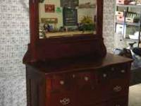 Solid wood dresser with beautifully framed, detailed