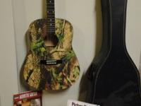 Camo guitar, comes with two chord books and case , the