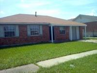 This is a 3 bedroom 2 bath, brick ranch home that needs