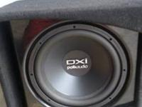 "12"" Polk DXI sub enclosed in a custom-made cherrywood"