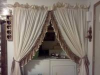 ONE SET OF CURTAINS THEY ARE CREAM AND BROWN WITH TIE