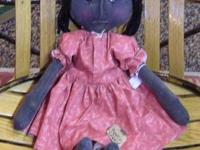 This is a hand-made primitive doll named Rooty Tooty
